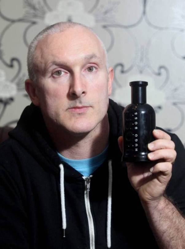 Ian Olver from Plymouth, Devon, who was attacked by his neighbours cat. See swns story SWSMELL. A dad suffered a serious facial injury after he was attacked by a neighbour's cat because it hated -- his AFTERSHAVE. Plasterer Ian Olver, 44, had splashed on the Hugo Boss Bottled Night scent after it was given to him by his wife Hayley, 40, as a Christmas present. Ian put it on for the first time last week before popping down the road to see neighbours Mark and Lorraine Bawden . But the unsuspecting dad-of-two had no idea that their pet cat Blue has a PHOBIA of pungent aromas. The normally-placid puss leapt up at Ian and began clawing at his neck and ears as soon as it got a whiff of his pricey eau de toilette. He managed to fight off the crazed animal but was left with a three inch gash to the back of his head which required hospital treatment and a tetanus injection.